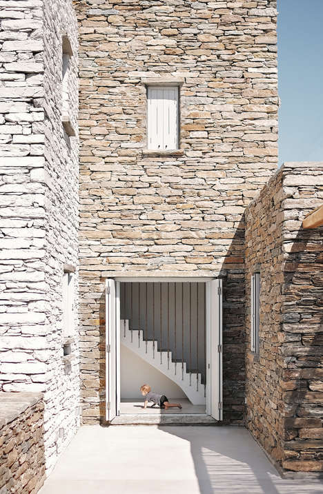 Rocky Modern Homes - Rocksplit House is Clad in Rough Hewn Stones
