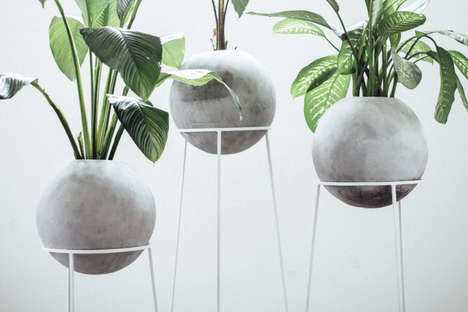 Orbed Concrete Planters - 'Piedra Luna' Features an Iron Base and a Large Circular Pot