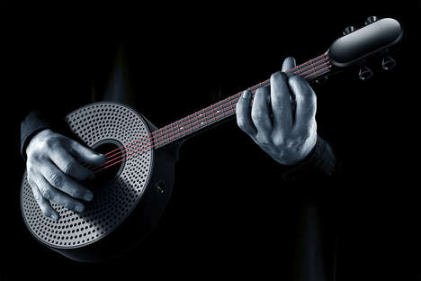 Interactive Education Ukuleles - The 'Yuan Man' Ukulele Uses Integrated Lights to Teach You to Play