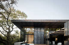 Weathered Steel House Exteriors - Faulkner Architects's Design is Shaded by Large Oak Trees