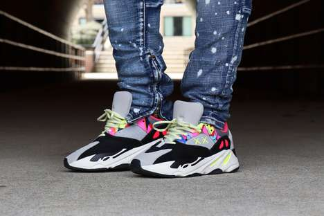 Customized Neon-Accented Sneakers - KAWS x YEEZY BOOST 700 Deliver The Bright Wave Runners