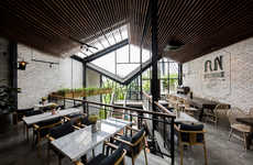 Labyrinth-Like Industrial Cafes - Le House Introduces a Green Oasis in An'garden Cafe