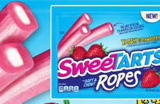 Flavor-Infused Licorice Candies - SweeTarts Tangy Strawberry Soft & Chewy Ropes are a Sweet Treat