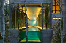 Clear-Walled Infinity Pools - Indoor Cantilevered Lap Pool Extends Into the Forest