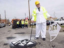 Chicken Filled Potholes - KFC Gets Into The Pothole Repairing Business
