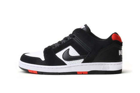 Classic Skater-Inspired Sneakers - Nike SB Bred Model Boasts a Sleek Black and Red Colorway