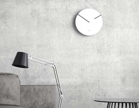Roundabout Wall Clocks - This Inverted Clock Features Hands That Rotate From Behind the Face