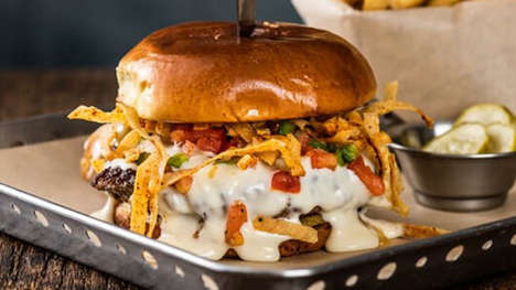 Tex-Mex-Inspired Burgers - The Chili's Queso Burger is Topped with Pico de Gallo and Tortilla Strips