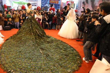 Strut-Worthy Wedding Gowns - Incredible $1.5 Million Dress Made of Peacock Feathers