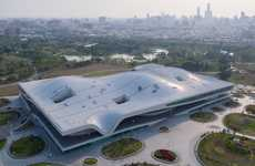 Sizable Wavy-Roofed Arts Centers