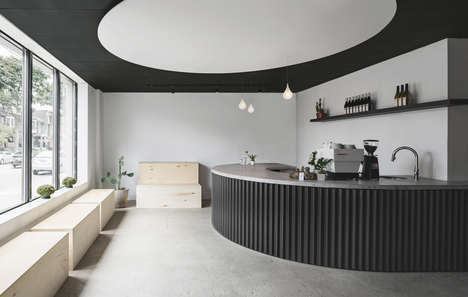Minimalist Contemporary Cafe-Barber Shops - This Store by StudioAC Features a Black & White Palette