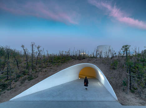 Secluded Cave-Like Galleries - OPEN Architecture Arranges a Network of Galleries Inside a Sand Dune