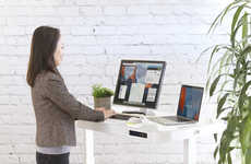 Designer Tempered Glass Workstations - The Seville Classics AIRLIFT Standing Desk is Multifunctional