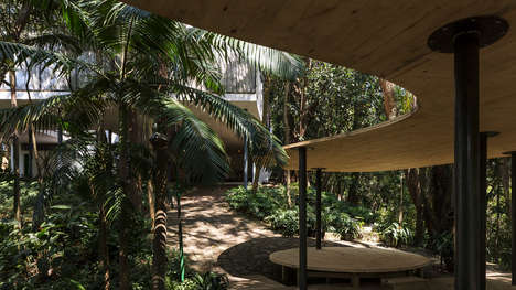 Curved Wooden Forest Pavilions