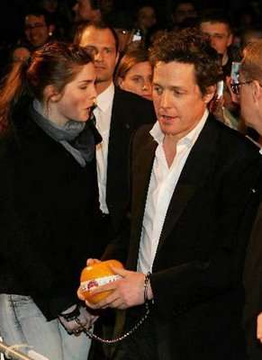 Obsessive Fans - Hugh Grant Handcuffed by Fan at Premiere