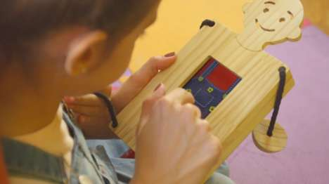 Phone-Powered Wooden Toys
