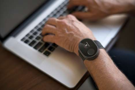 Hand Tremor-Alleviating Wearables