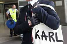 Celebrity Self-Parodies - Chanel's Lagerfeld Says 'Karl Who?' With Tote Bag