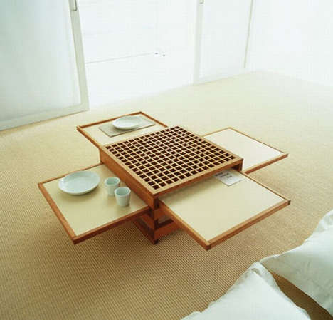 Pull-Out Place Settings - Sculptures Jeux Presents Collapsible Tables that Expand When Needed