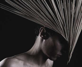 Darkly Sculptured Headdresses