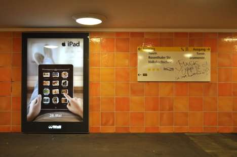 Naughty iPad Ads - Berlin iPad Adbusters Put Up a Scandalous Billboard in Rosenthaler Platz Subway