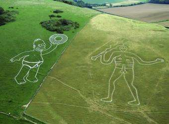 Ad Medium Monuments - Cerne Abbas Giant Gets Homer and a Donut