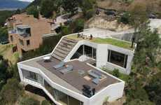Rooftop Garden Homes - The 'V House' by Plan B Architects has a Grass Field on Top