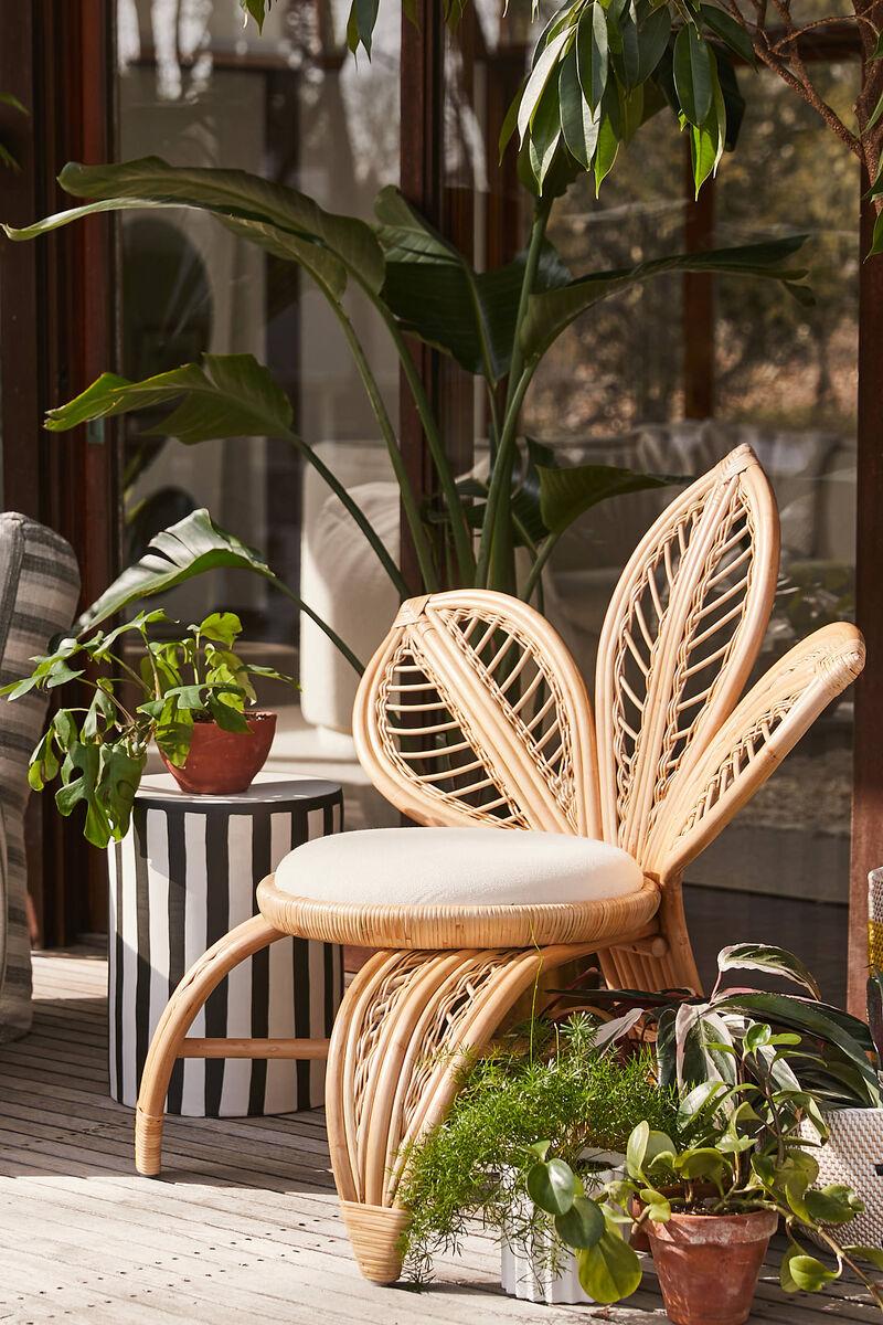 Elegant Flower-Inspired Rattan Chairs