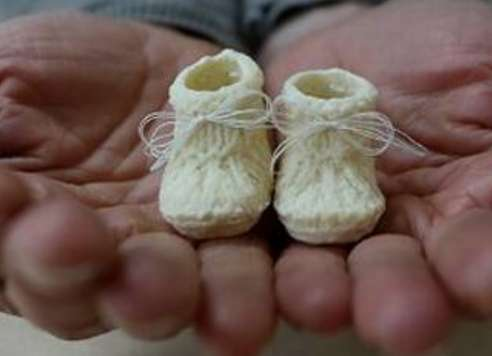 Lactate Infant Sneaker Sculptures