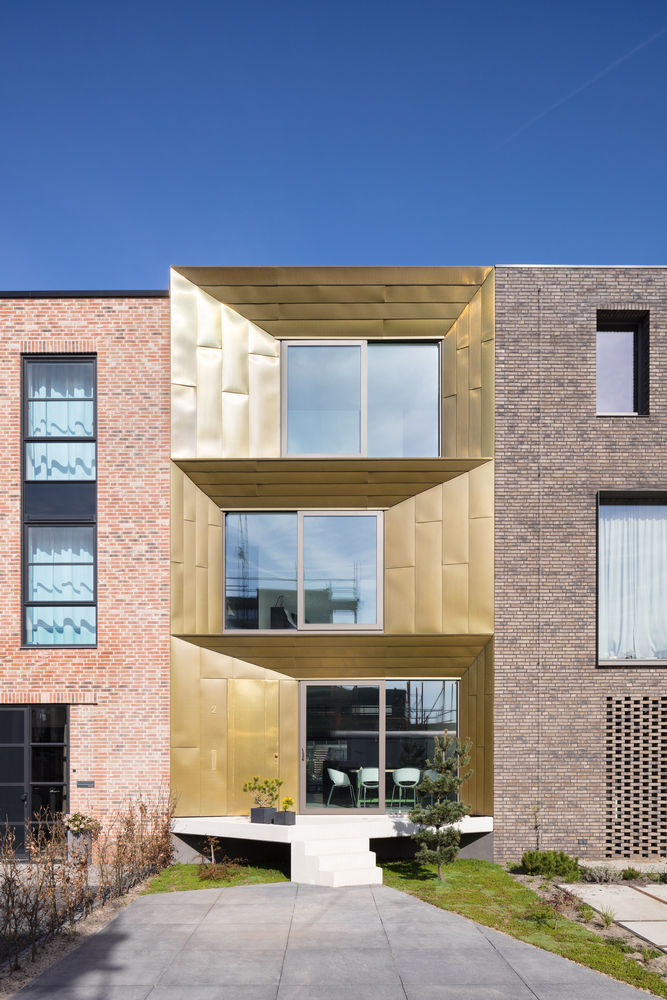 Bold Brass-Clad Homes