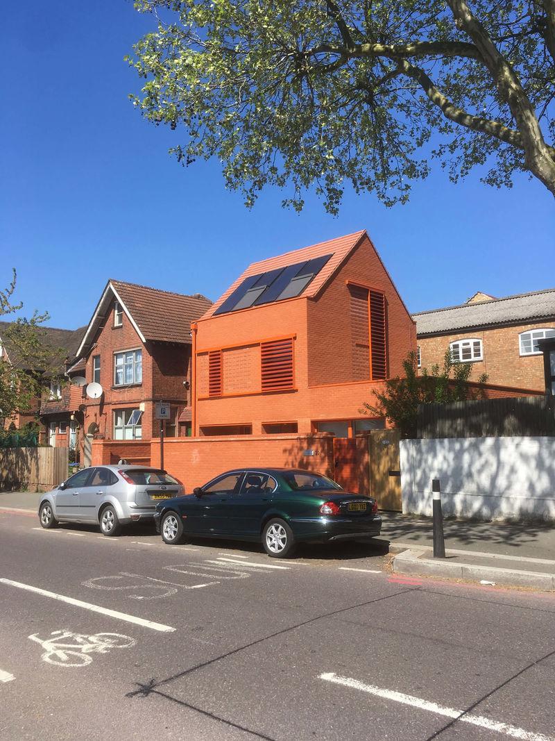 Eco-Friendly Bright Orange Homes