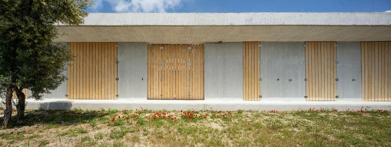 Minimalist Sloped Concrete Residences