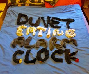 Duvet-Stealing Alarm Clocks