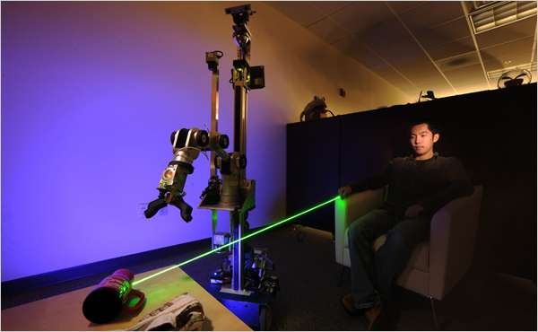 Laser Guided Robotic Assistant
