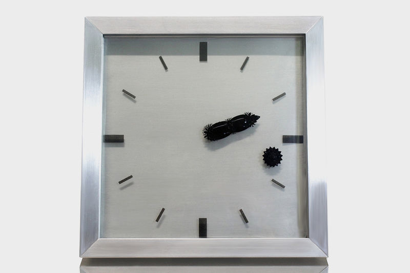 Magnetic Liquid Component Clocks