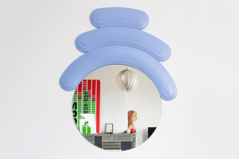 Figurine-Accenting Circular Mirrors