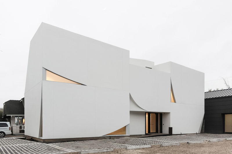 Sculptural White-Painted Facades