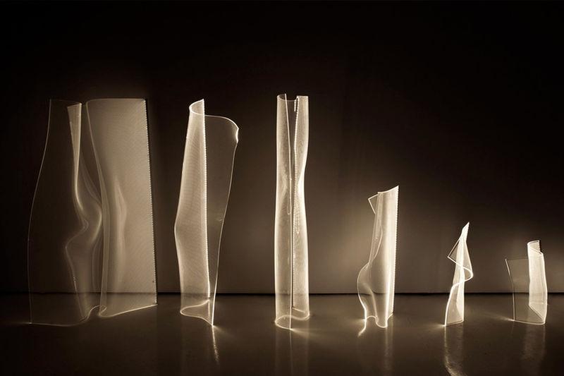 Fluid Illumination-Inspired Lamps