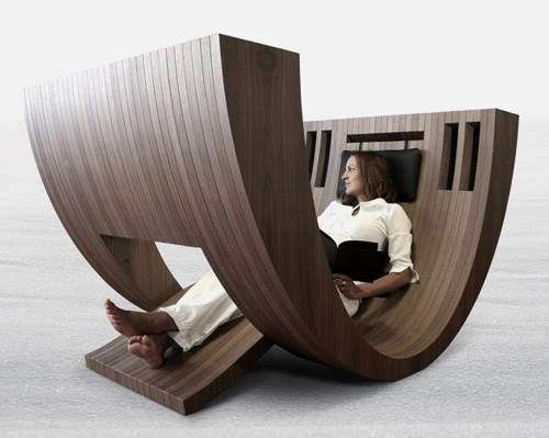 Curvilinear bookworm loungers kosha chair for Design lesesessel