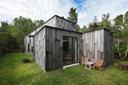 Wood-Paneled Forest Homes