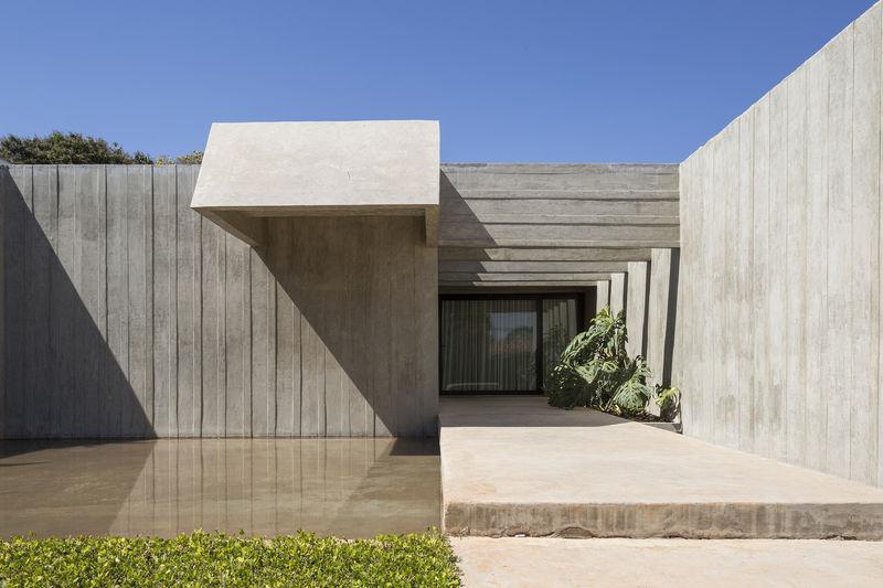 Low-Slung Blocky Concrete Homes