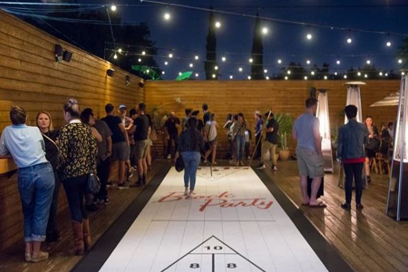 Community-Oriented Shuffleboard Bars