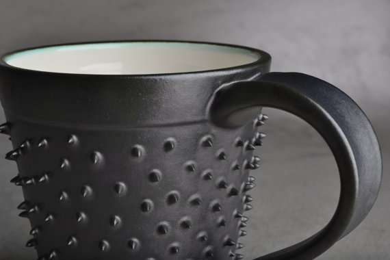 Sleek Gothic Ceramics Spiky Mug By Symmetrical Pottery
